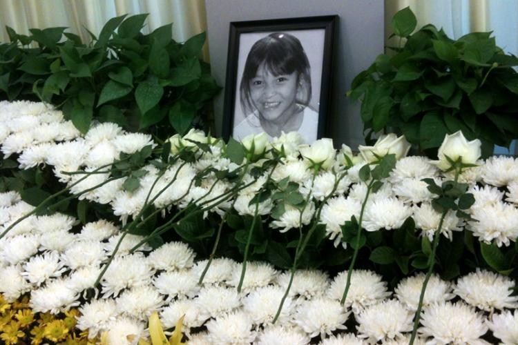 Memorial Service Recalls the Brief Life of 8-Year-Old Orphan as Her Body Remains in Morgue