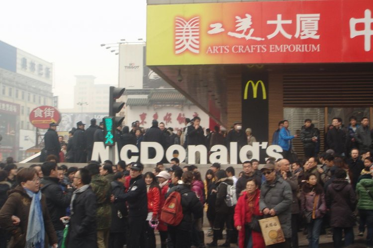 Fast Food Watch: McDonald's China could sell for USD 3 Billion; Starbucks Raises Prices