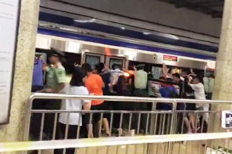 Beijing Commuters Rescue Trapped Man by Pushing Subway Train Off Him