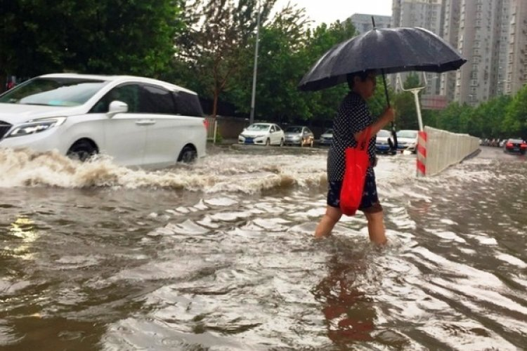 Beijing Beseiged by Flash Flooding as Heavy Rain, Hail Hammer City