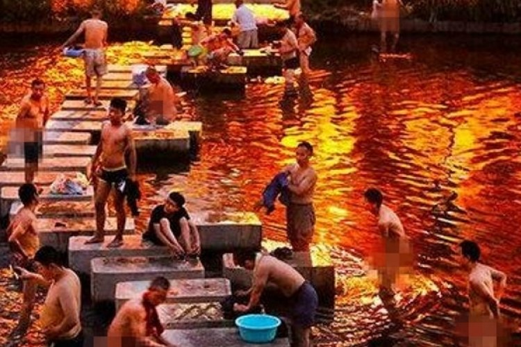 Free of Pollution, A Cleaned-Up River in Beijing Now Swarmed by Nude Bathers