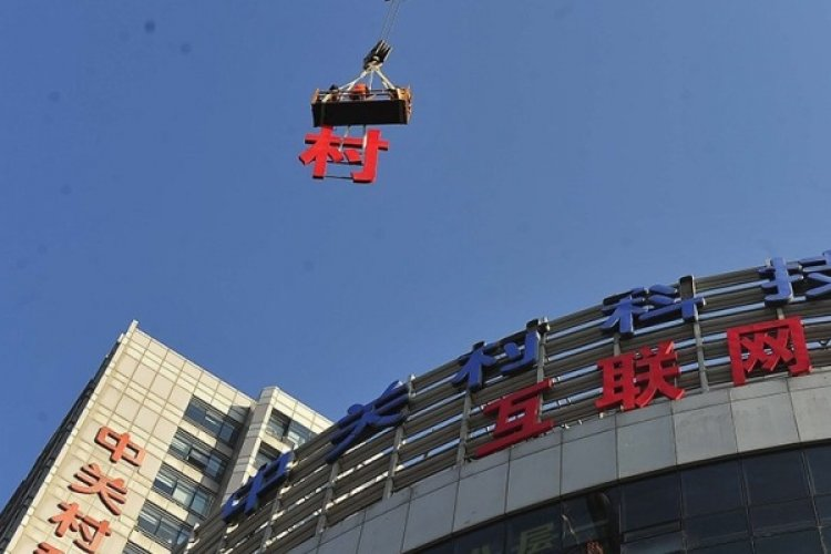 Sign of the Times: Beijing Skyline to Be Scrubbed Clean of Rooftop Advertisements