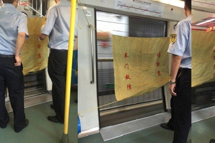 Beijing Subway Train Rumbles Down the Tracks With Door Wide-Open