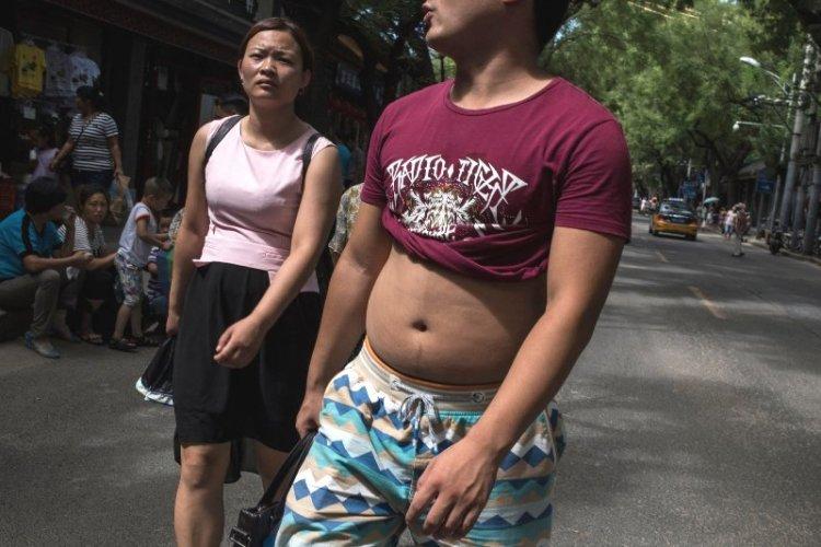 """Beijing Bikini"" Successfully Satirizes Chinese Custom of Exposing Beer Bellies"