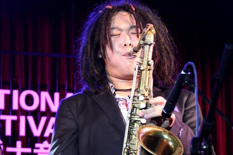 Q&A with Dreadlocked Saxophone Prodigy Li Gaoyang Ahead of his Aug 12 East Shore Gig