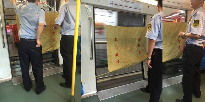 wide open doors. Beijing Subway Train Rumbles Down The Tracks With Door Wide-Open Wide Open Doors